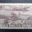 POLAND - CIRCA 1952: A stamp printed in POLAND shows an airplane flying over Warszaw and it was engraved by Czeslaw Slania, circa 1952 — Stock Photo