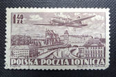 POLAND - CIRCA 1952: A stamp printed in POLAND shows an airplane flying over Warszaw and it was engraved by Czeslaw Slania, circa 1952 — Foto Stock