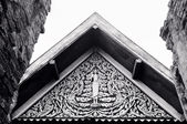 Black and white Tympanum in Buddhist temple — Stock Photo