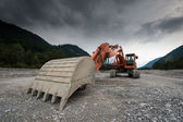 Perspective of digger shovel — Stock Photo