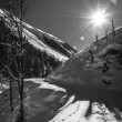 Sunny winter day at austrians mountains with ski tracks in snow — ストック写真