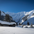 Cottages with snow on roof in austrian alps at winter — Stock Photo