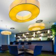 Stock Photo: Small hotel bar with huge lamps and bottle shelf