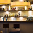 Stock Photo: Nice hotel lounge bar with bottle shelfs and seats, tables, lights