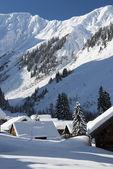 White snowy alps at mountain village in winter — Stock Photo