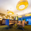 Wide angel of modern lounge in hotel bar with huge lamps — Stock Photo