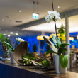 Stock Photo: Flower decoration at hotel reception