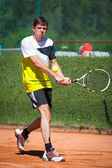 Two handed backhand of tennis player on sand court — Stock Photo