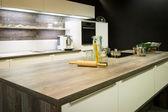 View into modern wooden optic kitchen — Stockfoto