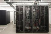 Backside of arranged black server racks in small computer room — Stock Photo