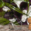 Standing cork of bottle with metal in front of bridal bouquet — Stock Photo