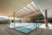 Interior view of swimming bath with pool with indoor laps — Stock Photo