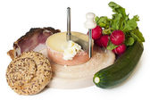 A meal or snack consisting of bread, cheese, bacon, green squash and radish — Stock Photo