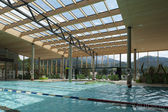 Indoor architecture of public swim bath with laps and glass roof — Stock Photo