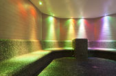 Colored lights in a steam bath with long tiled bench made with mosaic — ストック写真