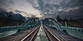 Mystical train bridge made of steel and dramatic sky at sunset — Stock Photo