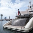 Stock Photo: View from stern of large luxury yacht moored to quay in marine harbour