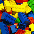 A lot of unsorted colored bricks — Stock Photo