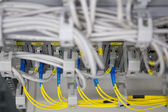 IT equipment with yellow fiber glass adapters to ethernet environment — Stock Photo