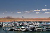 Several boats at landing point in lake powell with red desert and single mountain and coal-fired power station — Stock Photo
