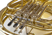 Detail of brass and silver horn or bugle with valves lying on a white background — Stock Photo