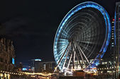 Europe, great britain, the big illuminated wheel of manchester standing in middle of the christmas market — Stock Photo
