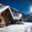 Winter ski chalet and cabin in snow mountain landscape — Stock Photo #38764931