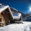 Winter ski chalet and cabin in snow mountain landscape — Stock Photo
