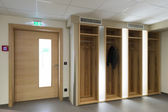 Wooden illuminated garderobe next door with clothes hanger — Stock Photo