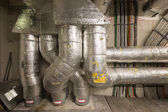 Technical room with insulated pipes power and data cables — Stock Photo