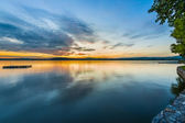 Blue golden sunset at lake wallersee with reflection in water — Stock Photo