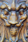 Devil on the front door, church of Hesdin,France — Stock Photo