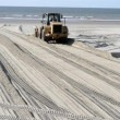 Stock Video: Bulldozer on the beach