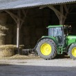 Stock Photo: Farmyard and farm tractor