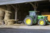 Farmyard and farm tractor — Stock Photo