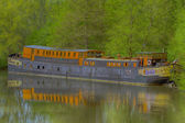Old barge for habitation on the river Somme in hdr — Stock Photo