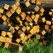 Stack of wood veneer lumber on sunset light — Stock Photo