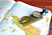 Compass and maps — Stockfoto