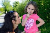 Little girl smelling a flower — Stock Photo