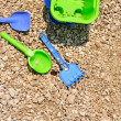 Bucket, spade and shovel on the pebbly beach — Stock Photo