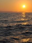 Sunset at sea with ripples — Stock Photo