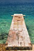 Wooden pier over beautiful sea — Stock Photo