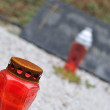 Burner and candle on tomb — Stock Photo