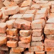 Stack of old used bricks — Stock Photo
