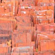 Stack of red ceramic roof tiles — Stock Photo