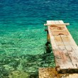 Wooden pier over beautiful adriatic sea — Stock Photo