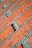 Brick wall in close up and in perspective — Stock Photo