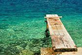 Wooden pier over beautiful adriatic sea — Stock Photo
