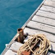 Coiled marine rope on wooden pier — Stock Photo