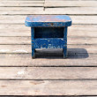Old small wooden blue fishing chair on wooden fishing pier — Stock Photo